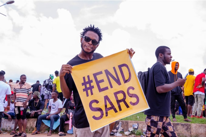 nigerian youths protesting around the city about end sars, end bad government, end police brutality in nigeria