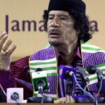 libya leader muammar gaddafi wearing an african tribal outfit attends the opening session of the forum of traditional kings sultans princes and sheikhs of tribes in africa in benghazi