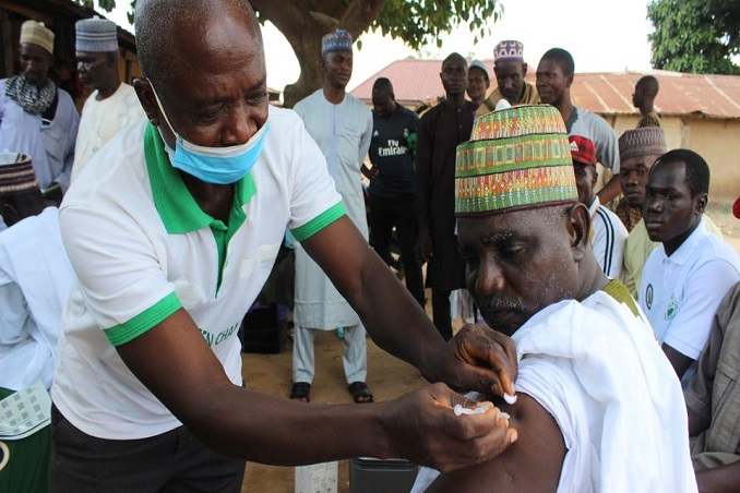 near the mosque in abuja worshippers offered virus vaccinations